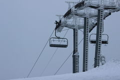 SKI CHAIRLIFT. Empty ski chairlifts on a mountain ski resort in slovakia Velka Raca in winter Royalty Free Stock Photo