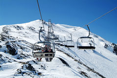Ski Chairlift in Italy. A photo of a ski slope chair lift in the Mont-Blanc district Royalty Free Stock Photos