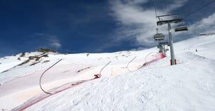 Ski chairlift on mountainside Royalty Free Stock Photos