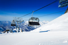 Ski chairlift over mountains on winter resort Stock Photos