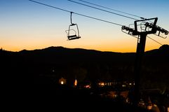 Ski Chairlift at Sunset. Silhouette of a chairlift at sunset on a ski slope in Aspen, Colorado.  Let the nightlife begin Royalty Free Stock Images