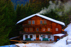Ski chalet. Traditional Austrian mountain chalet in winter royalty free stock photography