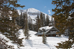 Ski Chalet. Secluded Chalet with ski mountain in the background stock images
