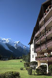 Ski chalet hotel, European alps, vertical copy space Royalty Free Stock Photos