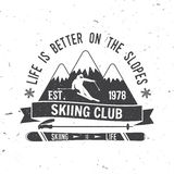 Ski club concept with skier. Ski club concept with skier who skiing downhill in high mountains. Vector ski club retro badge. Concept for shirt, print, seal or Royalty Free Stock Photo