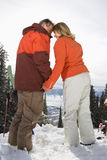 Ski Couple in Snow Holding Hands Royalty Free Stock Images