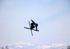 Ski crossover  off a big jump in hanazono park Stock Image