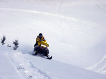 Ski-Doo In Snow. Ski-Doo Riding up hill on snow in the winter, Labrador Stock Images