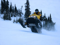 Ski-Doo taking Jump. In Labrador, Newfoundland Royalty Free Stock Photo