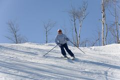Ski downhill. Ski woman downhill Royalty Free Stock Images