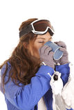 Ski drinking from mug Stock Images