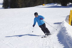 Ski driving woman Stock Photos