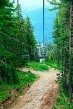 Ski elevator. Nobody on ski lift above the ski slope Royalty Free Stock Images