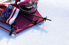 Ski equipment and snow background, clothes, poles, white snow copy space Stock Image
