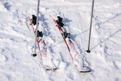 Ski equipments on ski run. Royalty Free Stock Image
