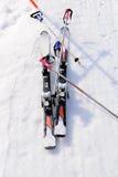 Ski equipments on ski run. Royalty Free Stock Photo