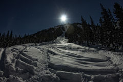 Ski freeride trail at night in moonlight Stock Images