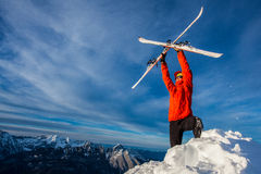 Ski freeride. Young man posing with freeride ski on a mountain summit Royalty Free Stock Images