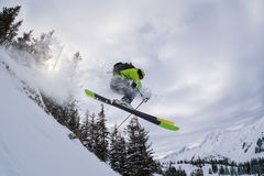 Ski freerider jumping thourgh trees Royalty Free Stock Photos