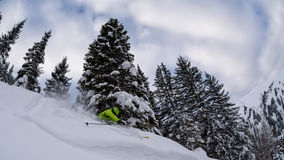 Ski freerider ripping thourgh trees Stock Photography