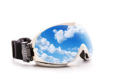 Ski glasses with sky reflection Royalty Free Stock Image