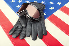Ski goggles and gloves over USA flag - close up studio shot Stock Photos