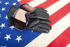Ski goggles and gloves over USA flag Royalty Free Stock Photography