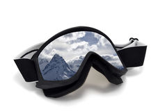 Ski goggles with reflection of snow mountains Stock Photos