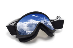 Ski goggles with reflection of snowy mountains Royalty Free Stock Images