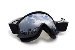 Ski goggles with reflection of winter snow mountains Royalty Free Stock Images