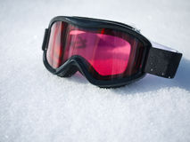 Ski Goggles on Snow. A pair of skiing goggles laying on a fresh snow Stock Images