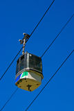Ski Gondola with blue sky. A ski cabin going up in the French Alps Royalty Free Stock Photos