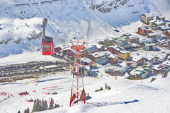 Ski gondola cable car in Lech - Zurs ski resort in Austria. Ski gondola - cable car and a bird's eye view of the hamlet of Zurs and the Lech - Zurs ski resort in Royalty Free Stock Image