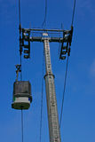 Ski Gondola and Pylon with blue sky. A ski cabin going up in the French Alps Royalty Free Stock Images