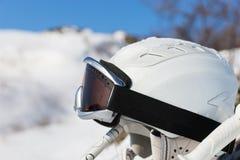 Ski helmet between poles in front of mountain Stock Images