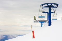 Ski Hill Chair Lift. An image from the top of a ski resort's chair lift Royalty Free Stock Image
