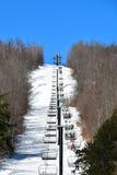 Ski hill chair lift Stock Photo