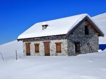 Ski hut in winter snow, Prato Nevoso, Province of Cuneo, Italy stock image