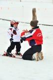 Ski instructor explain ski techniques to children Royalty Free Stock Photo