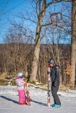 Ski instructor and little girl Royalty Free Stock Photography