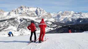 Ski instructor and skier in Dolomites stock image