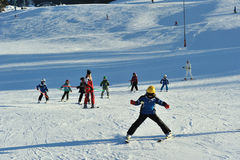 Ski instructor with small children on ski slope Stock Photography