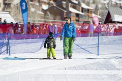 Ski Instructor Teaching a 3-Year Old Toddler Boy at a Mountain Resort royalty free stock photos