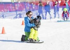 Ski Instructor Teaching a 3-Year Old Toddler Boy at a Mountain Resort stock image