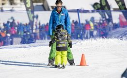 Ski Instructor Teaching a 3-Year Old Toddler Boy at a Mountain Resort stock images