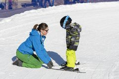 Ski Instructor Teaching a 3-Year Old Toddler Boy at a Mountain Resort royalty free stock images