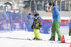 Ski Instructor Teaching a 3-Year Old Toddler Boy at a Mountain Resort stock photography