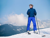 Ski instructor young man on the top of snow hill Stock Image