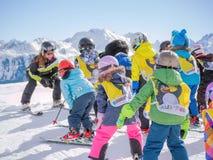 Ski instructors study young skiers. Austria, Zams on 22 Feb 2015 Royalty Free Stock Photo