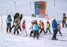 Ski instructors study young skiers. Ski resort in Alps, Austria, Stock Image
